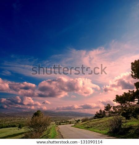 asphalt road to the mountians - stock photo