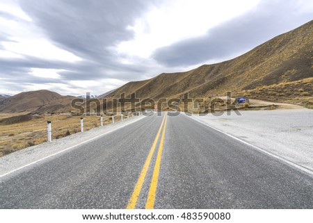 Asphalt road with lenticular cloud at south of New Zealand