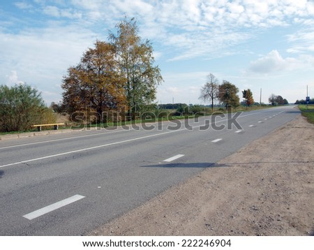Asphalt road with marker lines in rural district        - stock photo