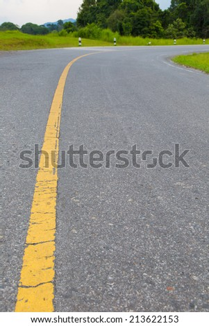 Asphalt road with marking lines.