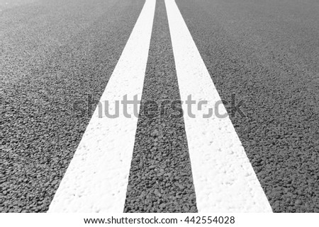Asphalt road with marking lines white stripes. Two solid lines