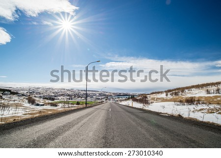 Asphalt road with mountain at Husavik , Iceland - stock photo