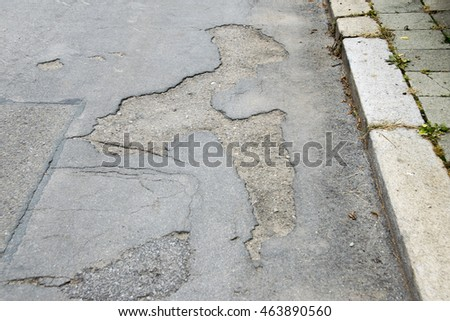 Asphalt road with pothole