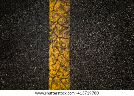 Asphalt road with separation yellow lines