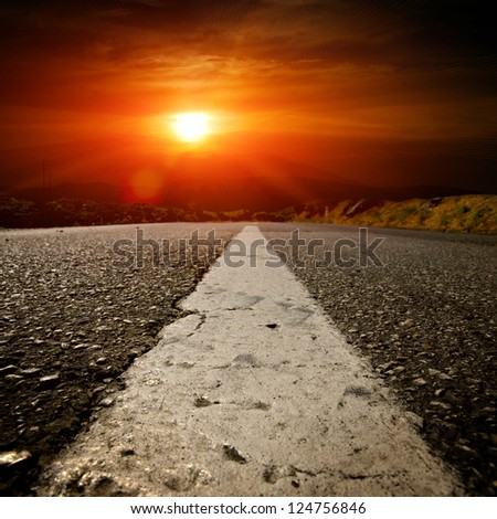 asphalt road with the blue sky