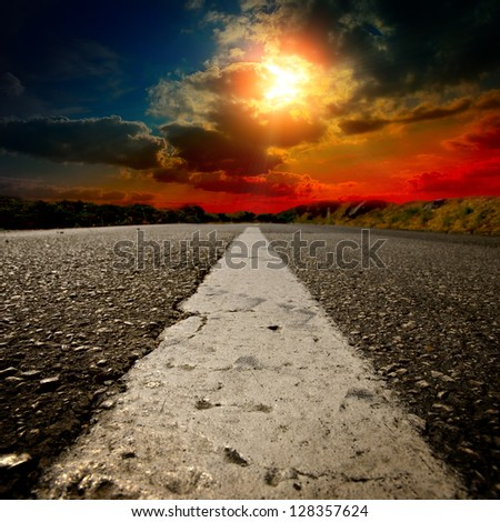 asphalt road with the blue sky - stock photo