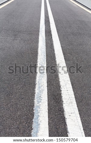 Asphalt road with white double solid line - stock photo