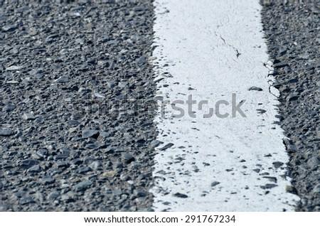 asphalt road with white line on center - stock photo