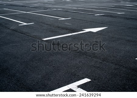 Asphalt surface of the empty parking with white road marking lines - stock photo