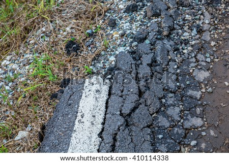 Asphalt surface, the curve of the road were demolished due to poor construction. - stock photo