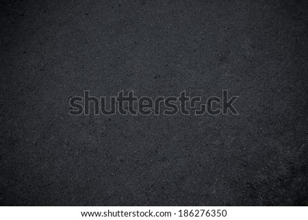 Asphalt texture. Background texture of rough asphalt - stock photo