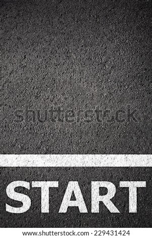 Asphalt texture background with white line and start word - stock photo