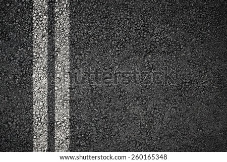 Asphalt texture with two separation white lines - stock photo