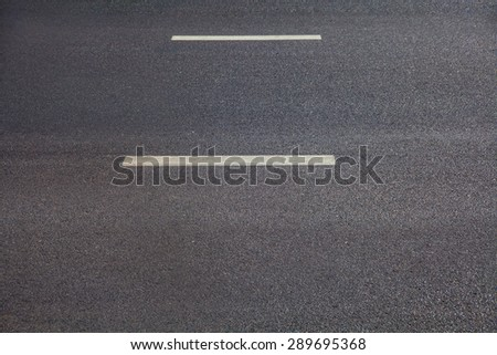 Asphalt texture with white dashed line - stock photo