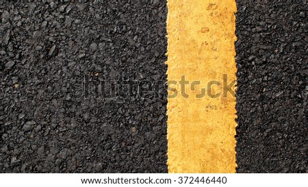 Asphalt texture with yellow line.