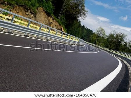 Asphalt twisty mountain road in hills in Slovakia - stock photo