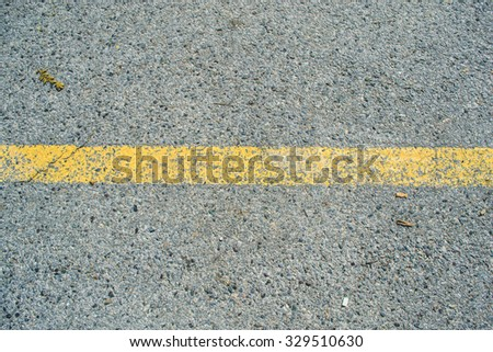 Asphalt with yellow road line - stock photo