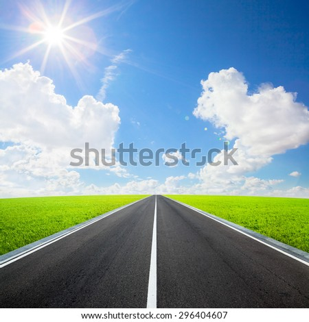 asphalted highway over blue sky with white clouds background