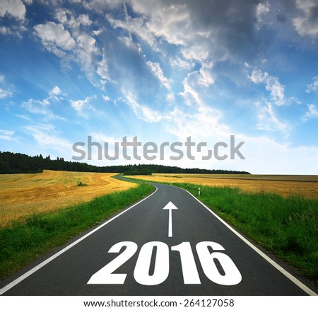 Asphalted road at sunset .Forward to the New Year 2016 - stock photo