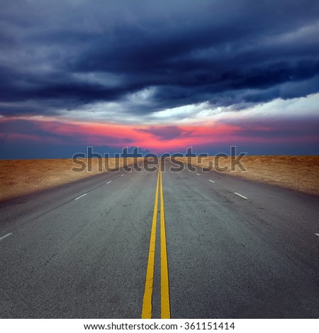 Asphalted road in a storm - stock photo
