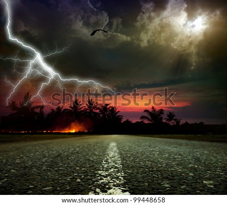 Asphalted road in a storm