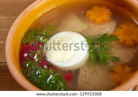 Aspic from meat decorated with egg, carrot,