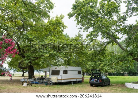 ASPROVALTA, GREECE- JULY 15, 2014: Caravan in organized camping in summertime in Asprovalta, Greece. Many tourists are choosing camping for their summer in Greece.