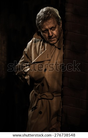 Assassin Stalker - Russian Spy - Man with Hand in Trench Coat - Creepy Killer Lurking in Doorway - Dangerous Hitman in Shadows - Stranger Stalking with Gun - Noir Style Secret Agent Vintage Detective - stock photo