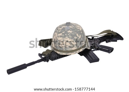 assault rifle and helmet  on white background - stock photo