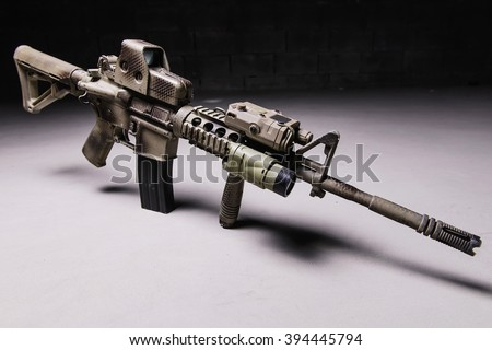 Assault rifle with camouflage pattern,optical and laser sight/Assault rifre - stock photo