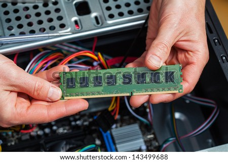 Assemblage of a ram memory stick card - stock photo