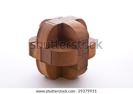 Assembled wooden burr puzzle on white background