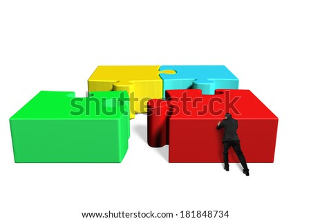 Assembling four puzzles isolated in white background - stock photo