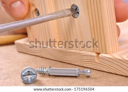 Assembling furniture. - stock photo