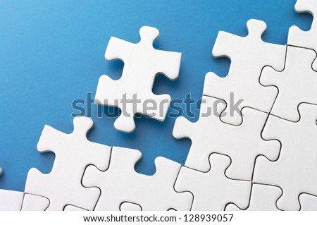 Assembling puzzle pieces.Concept image of building and growth.