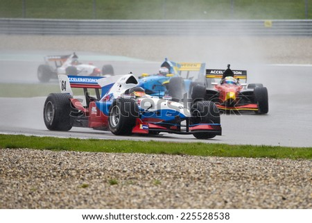 ASSEN, NETHERLANDS - OCTOBER 19, 2014: Team Slovenia in the lead of the Formula A1 GP division during a wet race on the TT circuit, Assen - stock photo