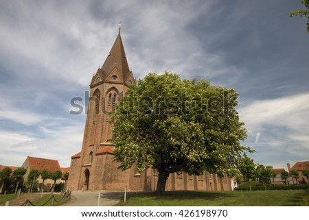 ASSENS, DENMARK - MAY 22: Blooming chestnut close to big church in Assens. May, 22 2016 Assens, Funen, Denmark. - stock photo