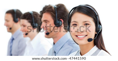 Assertive business people talking on headset in a call center