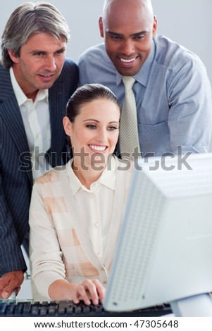Assertive business people working at a computer in the office