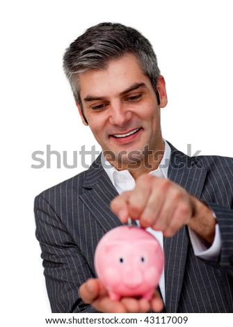 Assertive Businessman saving money in a piggybank against a white background - stock photo