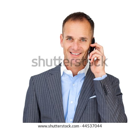 Assertive businessman using a mobile phone against a white background