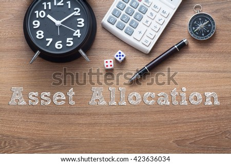 Asset Allocation written on wooden table with clock,dice,calculator pen and compass - stock photo