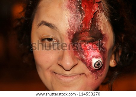 ASSIS, SAO PAULO/BRAZIL - SEPTEMBER 29: An unidentified woman dressed as a zombie, during the annual zombie walk on September 29, 2012 in Assis, Sao Paulo, Brazil. - stock photo