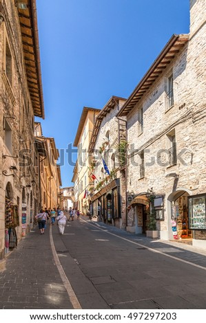 ASSISI, ITALY - AUG 31, 2015: Colorful medieval Via San Francisco