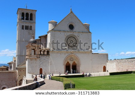 ASSISI, ITALY - JUNE 24, 2015: People at Basilica di San Francesco on top of the hill in Assisi, Italy