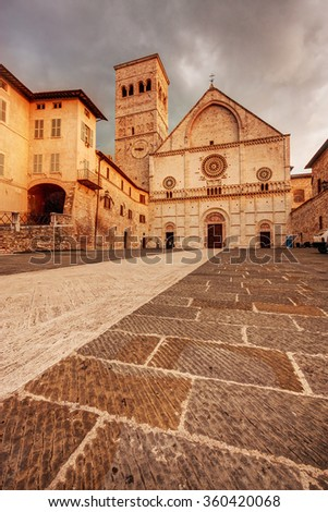 Assisi, Italy: San Rufino's Cathedral at sunset - stock photo