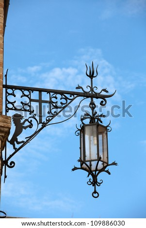 Assisi - old street lamp - stock photo