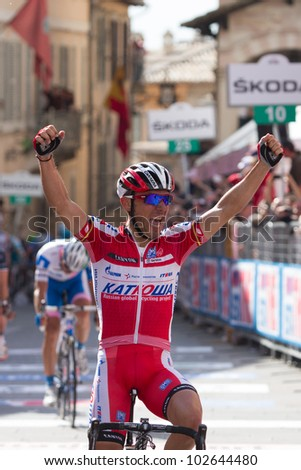 ASSISI, PERUGIA, ITALY - MAY 15: Joaquin Rodriguez, Team Katusha, wins the final sprint of the 10th stage of 2012 Giro d'Italia on May 15, 2012 in Assisi, Perugia, Italy - stock photo