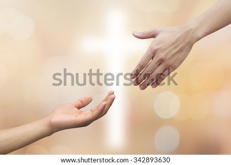 Assistance/supporting concept of helping hand and hands praying on blurred beautiful gold bulbs backgrounds with powerful cross.blessing strength concept.god/human relationship ideal:a truly believe. - stock photo