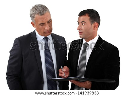 Assistant stood with boss - stock photo
